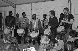 Daniel Verbaan with Babara Bangoura, Ibou Niang, Ousmane Seye, Bouba, Amara and Eef Bresser at the refugee centre in Veldhoven